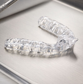 clear dental mouthguard on a table