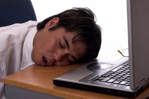 man asleep drooling on desk