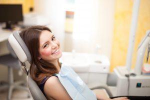 woman sitting in dentist chair