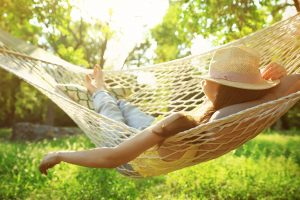 woman relaxing in hammock after Slope park dentist tooth extraction