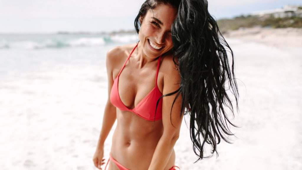 Woman smiling on beach